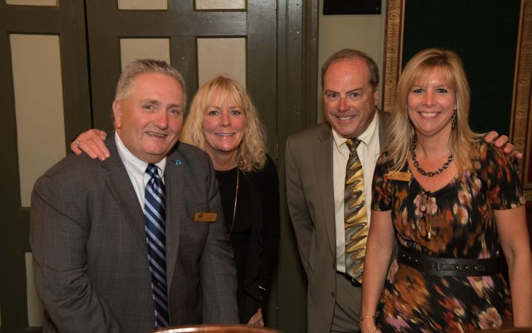Board of Directors member, Chief Operating Officer, and Executive Vice President of Thomaston Savings Bank, James R. Nichol of Torrington poses and smiles with other members of the TSB family at the 2019 Foundation Night.