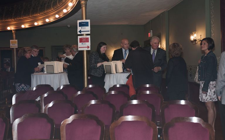 View of two groups of people standing around two tables at the 2017 TSB Foundation Night