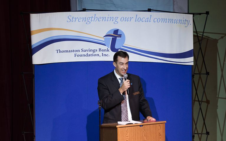 President of Thomaston Savings Bank, Stephen L. Lewis, at the podium with a microphone at the 2017 TSB Foundation Night