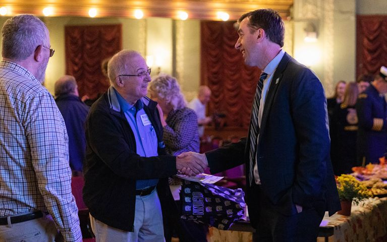 President of Thomaston Savings Bank, Stephen L. Lewis, shaking hands with a man at the 2018 TSB Foundation Night