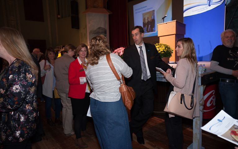 President of Thomaston Savings Bank, Stephen L. Lewis, talking with a woman at the 2017 TSB Foundation Night