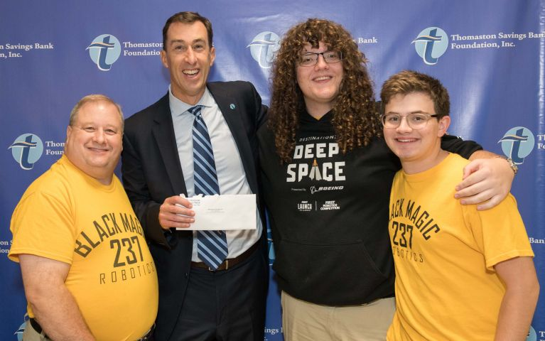 Team 237 Black Magic Robotics, a FIRST Robotics Competition team from Watertown High School in Watertown, Connecticut is presented with a check by the president and CEO of Thomaston Savings Bank, Stephen L. Lewis at the 2019 Foundation Night.