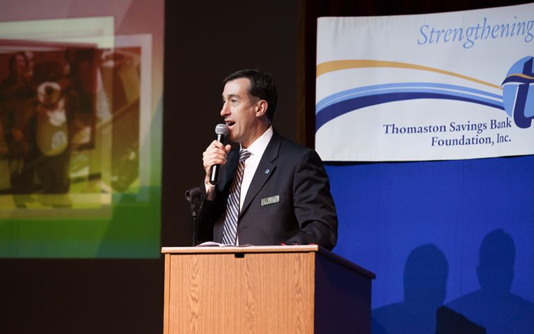 President of Thomaston Savings Bank, Stephen L. Lewis, giving a speech onstage at the 2017 TSB Foundation Night