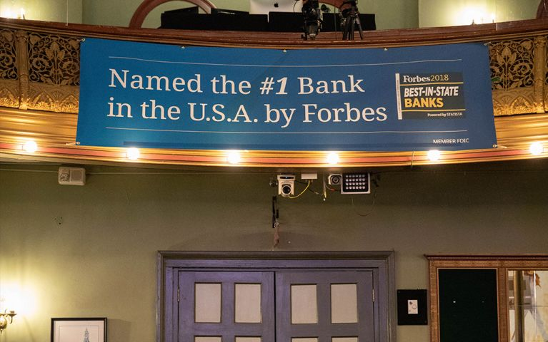 Banner with the words: Named the #1 Bank in the USA by Forbes hanging from the balcony at the 2018 TSB Foundation Night