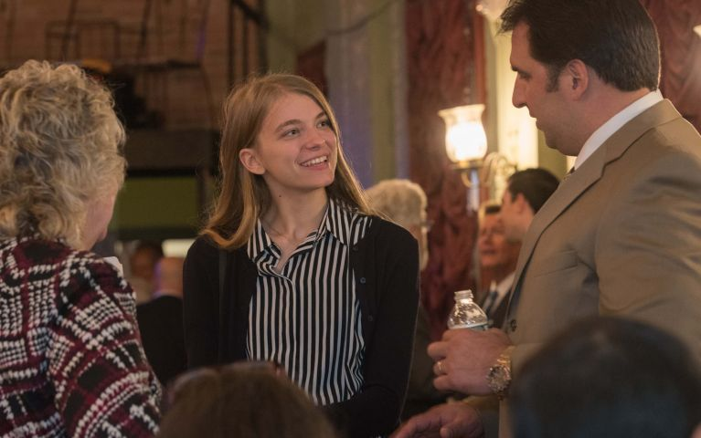A female attendee engages a male Thomaston Savings Bank member in conversation at the 2019 Foundation Night event.