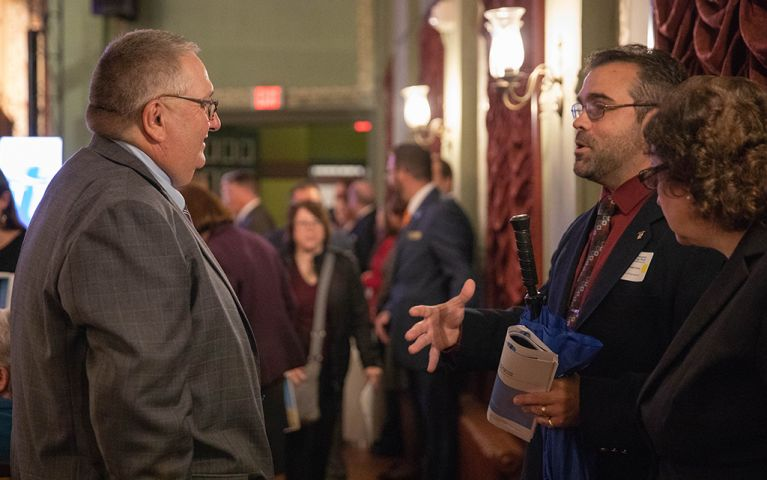 Two men having a conversation at the 2018 Thomaston Savings Bank Foundation Night