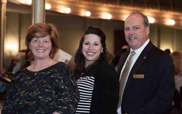 Two women and a man smile for a picture at the 2017 TSB Foundation Night